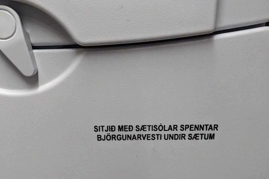 Icelandic writing on the tray table of an Icelandair flight.