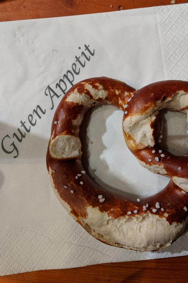 Enjoying a pretzel at Starkbierfest at Paulaner am Nockherberg in Munich, Germany.