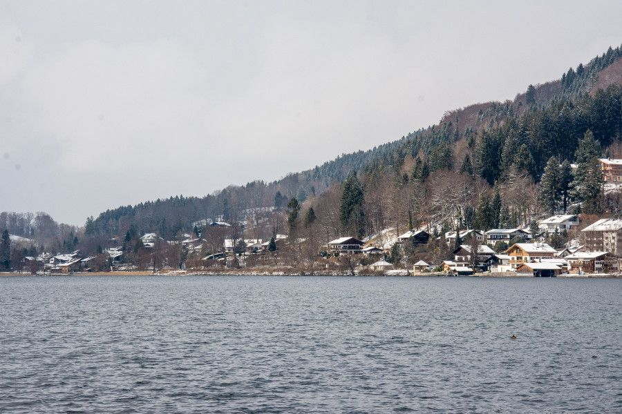 Houses on a hill seen across the Tegernsee lake.
