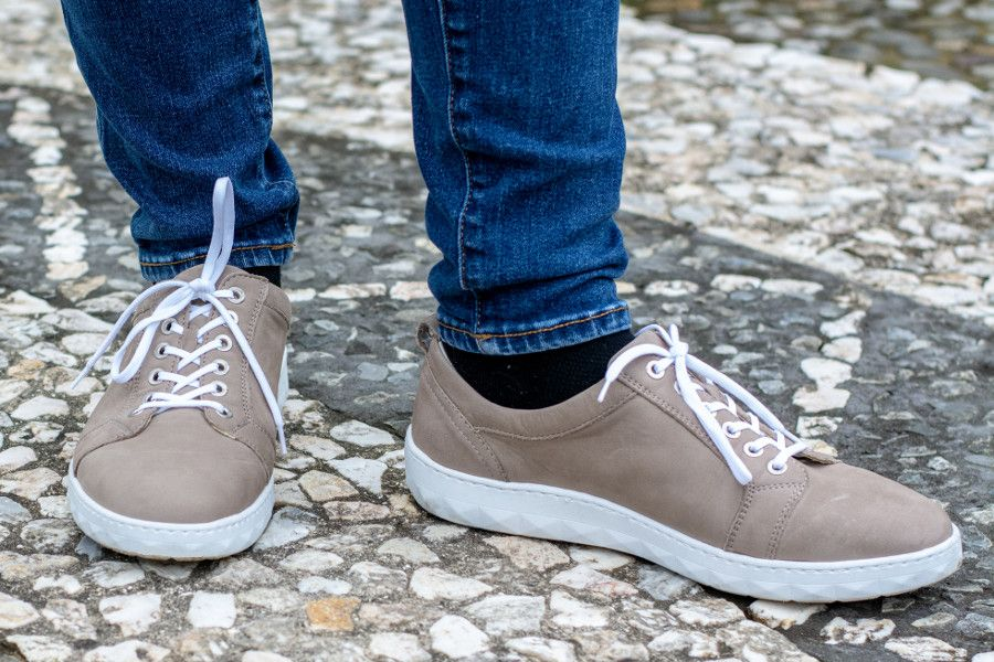 Close up of stepping out in a pair of Waldlaufer Mica Herne sneakers.