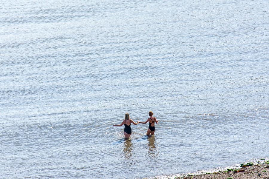 Two women go for a swim at Balscadden Bay Beach.
