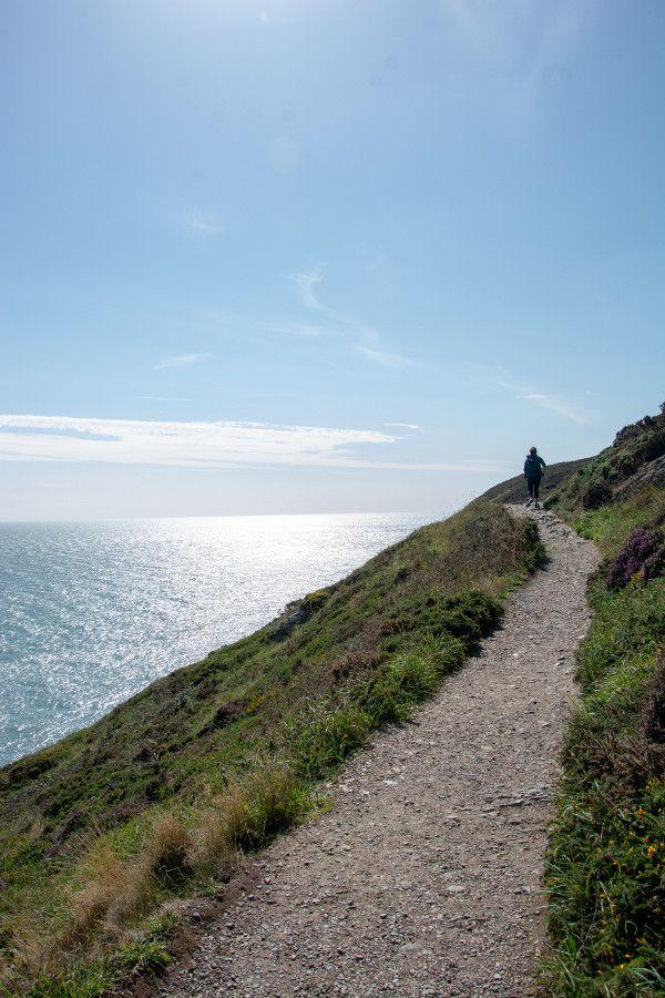 A hiker along the Howth cliff walk path.