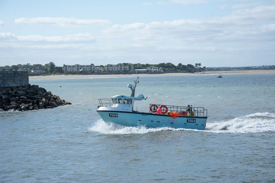 A ship heading into the Howth Harbor.