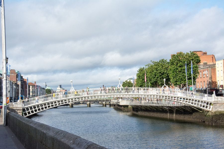 Ha'penny Bridge spanning the River Liffey in Dublin, Ireland.