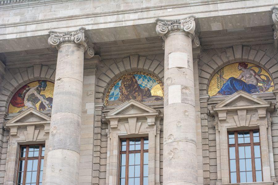 Mosaics decorate the exterior of the Bayerische Staatskanzlei in Munich.