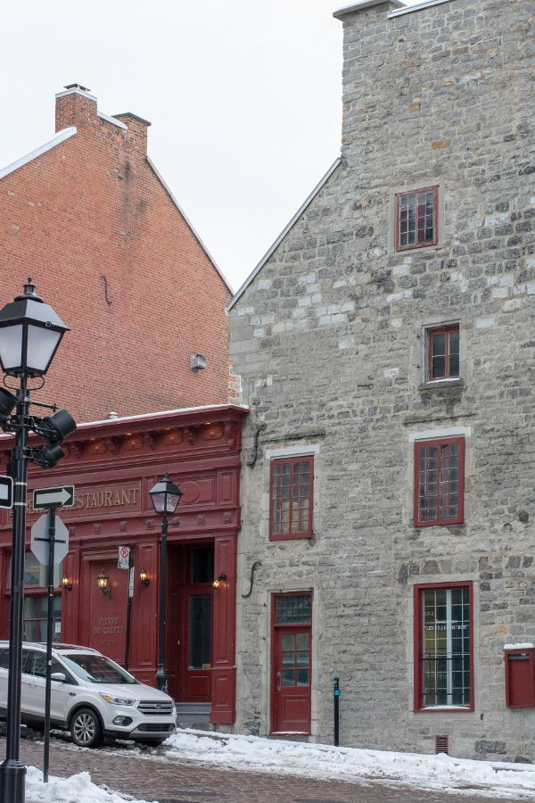 Shops line cobblestone streets in historic Old Montreal.