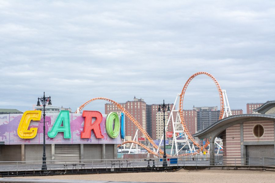 A view of the Coney Island carousel, roller coaster and board walk in winter.
