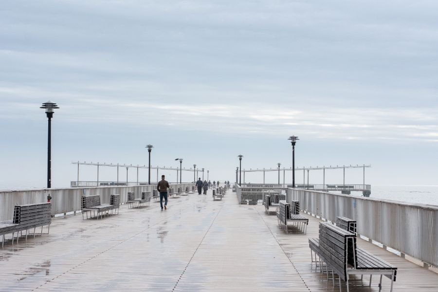 Walking out along the Pat Auletta Steeplechase Pier in Coney Island in winter.