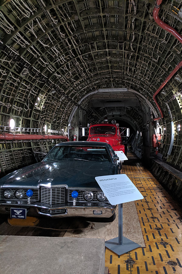 Two cars inside a C-133B Cargomaster.