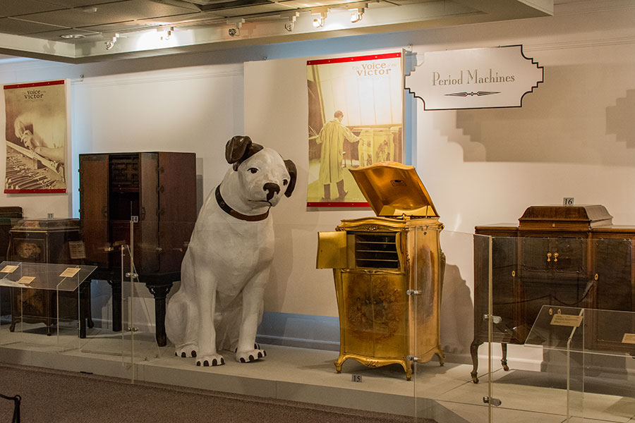 Exhibits upstairs at the Johnson Victrola Museum, including a golden Victrola and a larger than life Nipper statue.