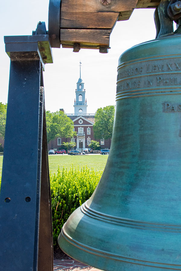 Delaware's Legislative Hall seen through a replica of the Liberty Bell.