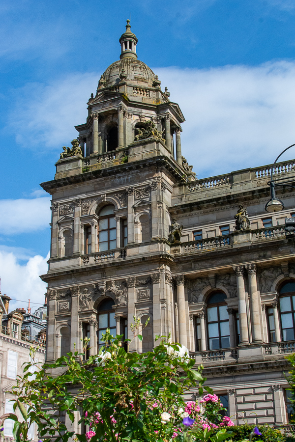 Flowers brighten the corner of the Glasgow City Chambers building.