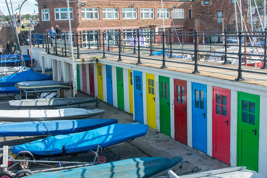 Brightly colored doors line the wall at the North Berwick Yacht Club in Scotland.