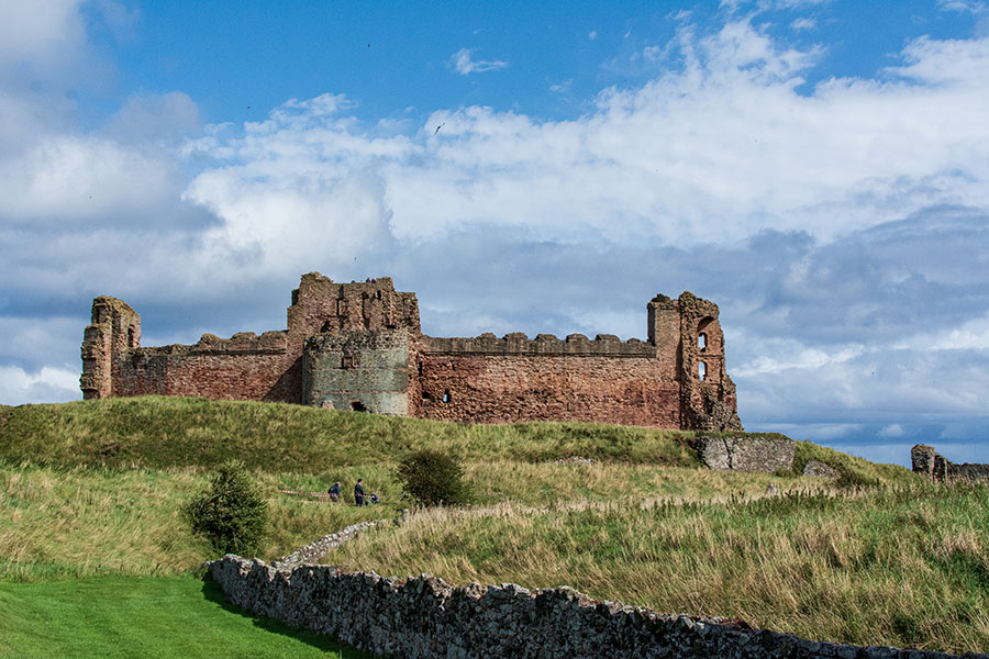 Tantallon Castle in North Berwick sits on the edge of a cliff overlooking the sea.