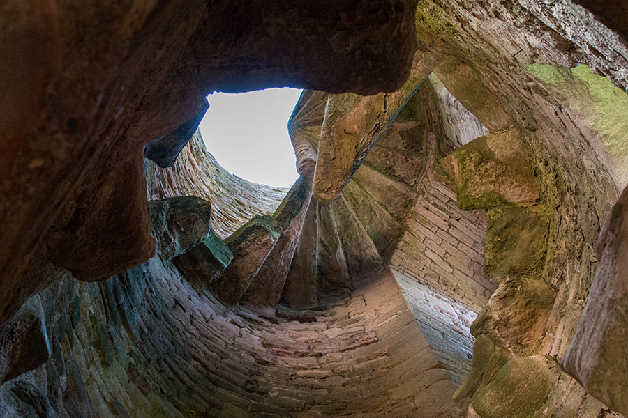 Looking up at the ruins of a spiral staircase in Tantallon Castle.