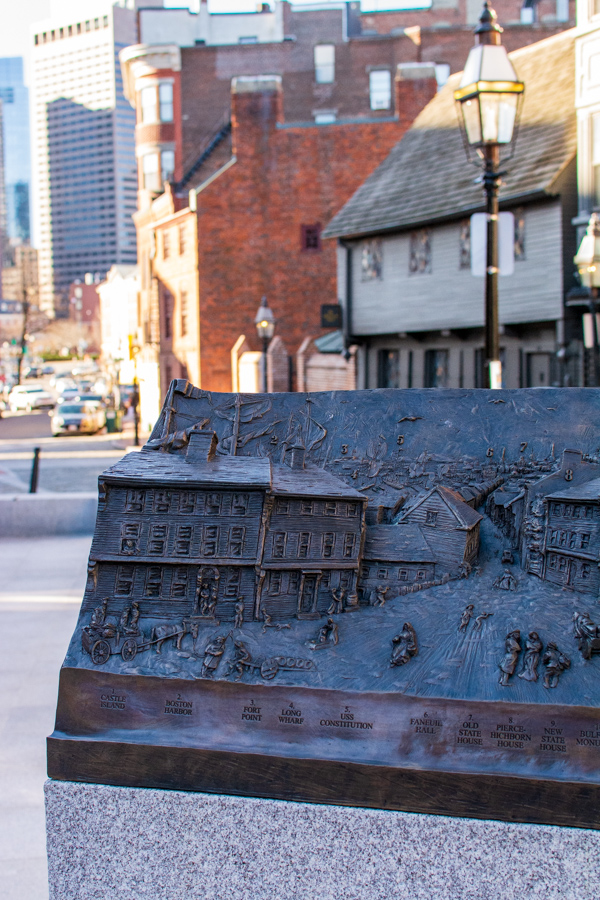 A monument outside the Paul Revere House imagines what the street looked like centuries prior.