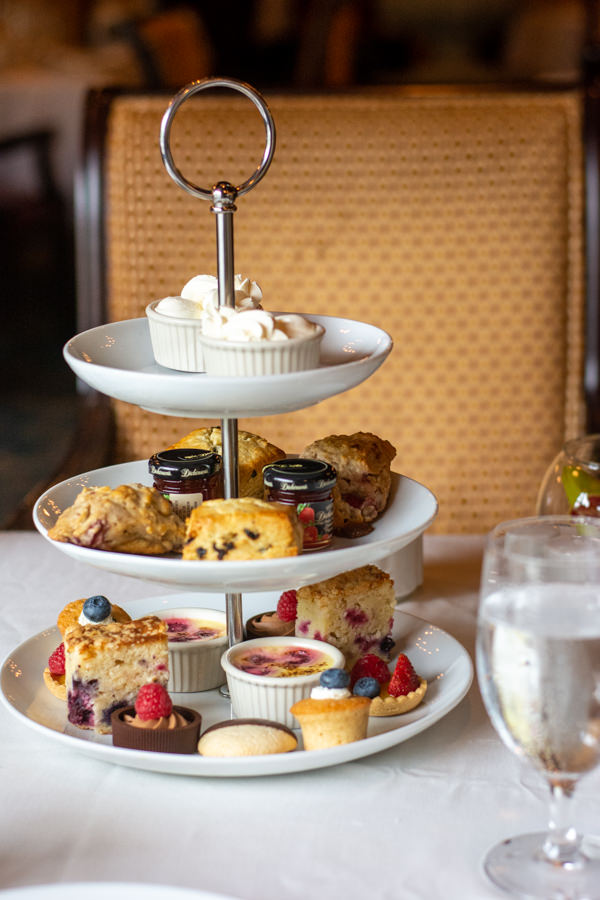Three tiers of scones, pastries, and sweets at the Hotel DuPont afternoon tea.