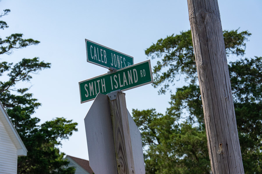 Street signs for Smith Island Road and Caleb Jones Road.