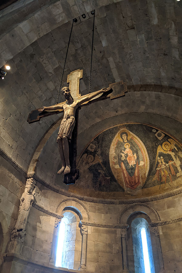 A crucifix hangs in the Fuentidueña Apse.