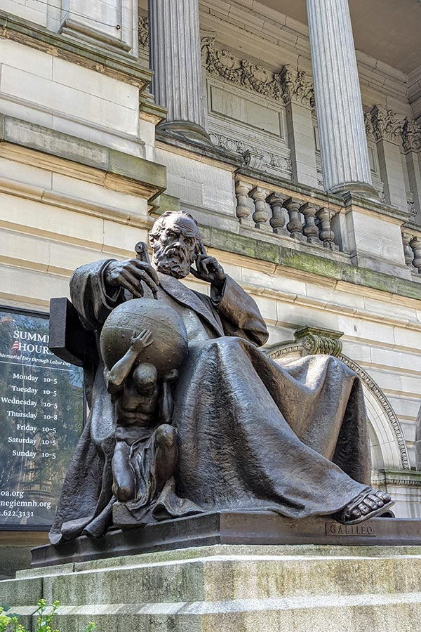 A sculpture of Galileo sits outside of the Carnegie Music Hall in Pittsburgh.