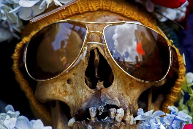 La Paz, Bolivia, skull wearing sun glassesl at the annual skull festival in the Cemetery General