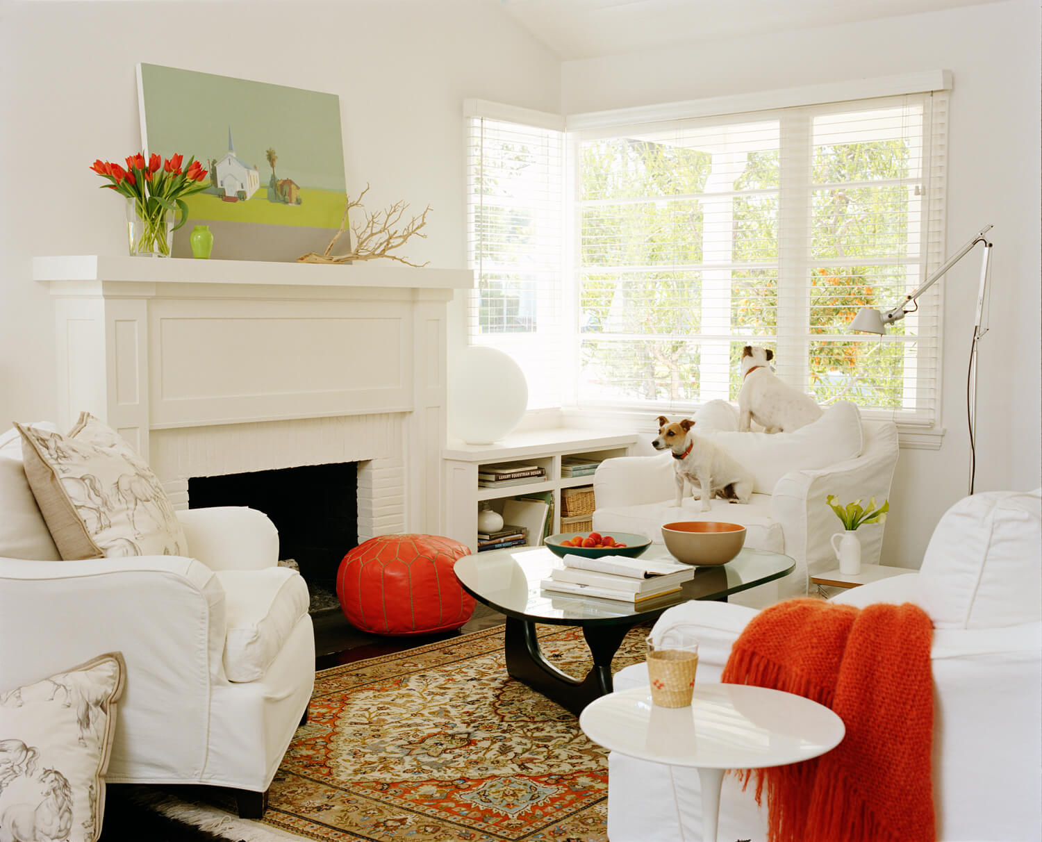 White Small Living Room with Orange Accents - Reverb