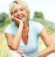 Reverse Type 2 Diabetes. The Genuine Blood Sugar Solution.  Image of happy beach woman