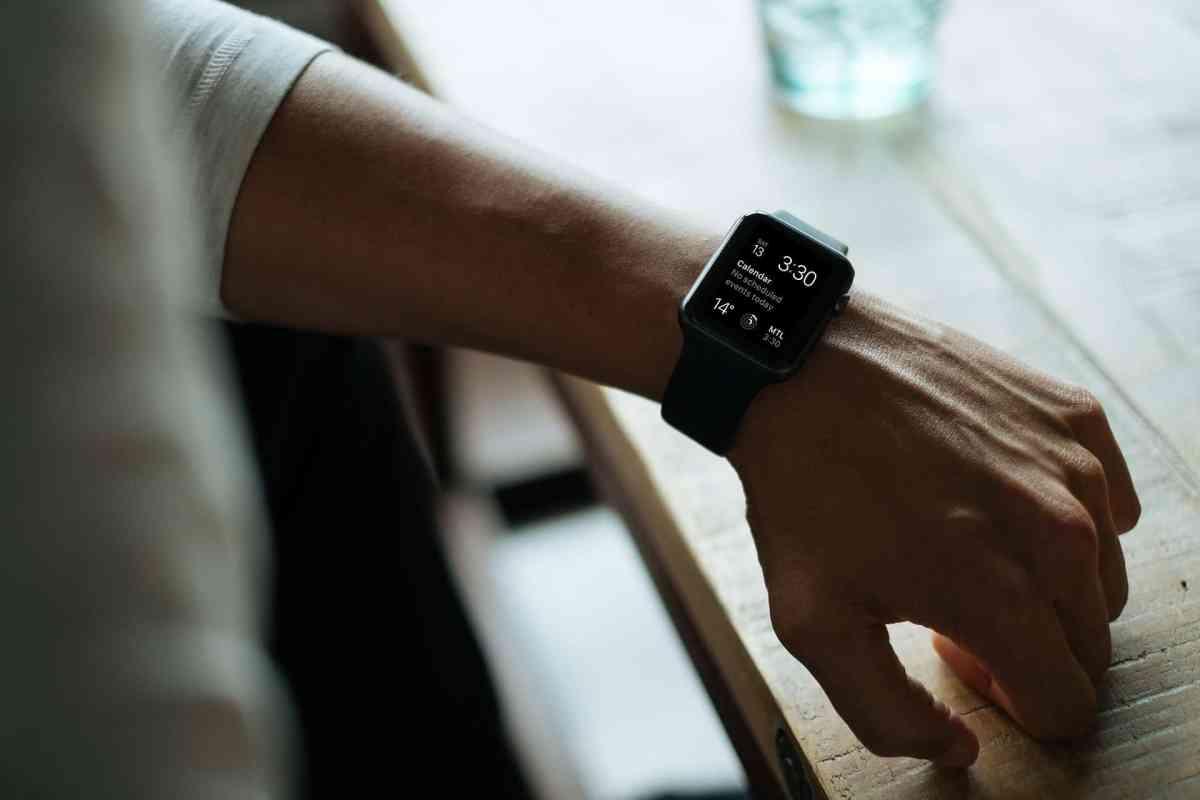Man wearing black Apple smartwatch.