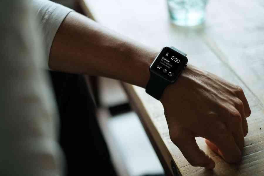 Man wearing black Apple smartwatch.