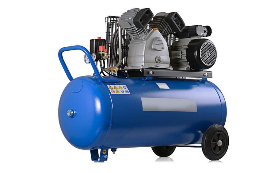 Compressor de ar azul com fundo branco.