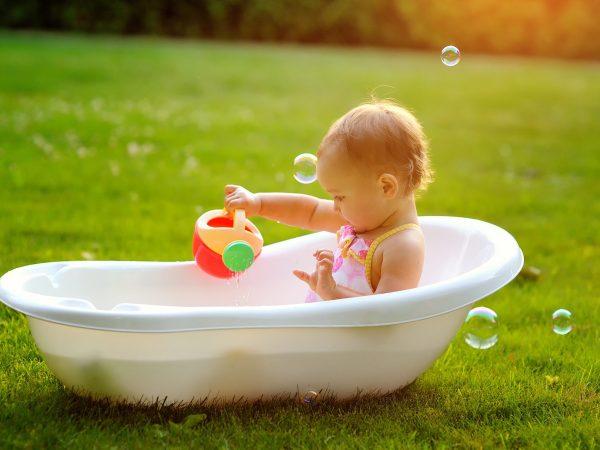 little girl sitting in the bath.