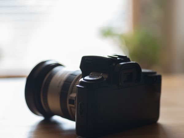 102106313 – an old analog camera on a table by the window