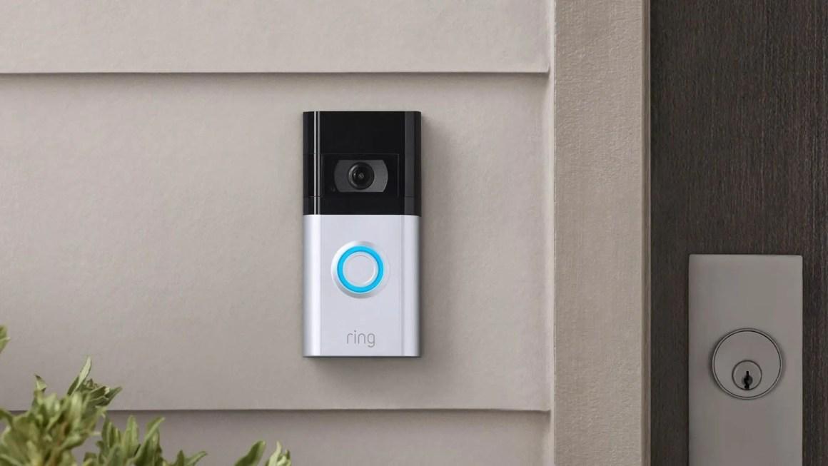 A Ring Video Doorbell 4 next to a door.