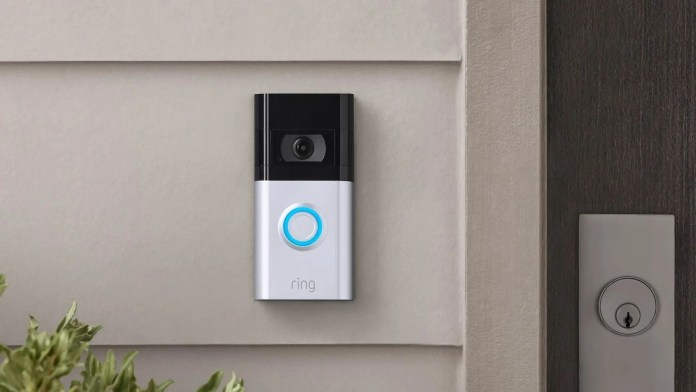A Ring Video Doorbell 4 next to a door.