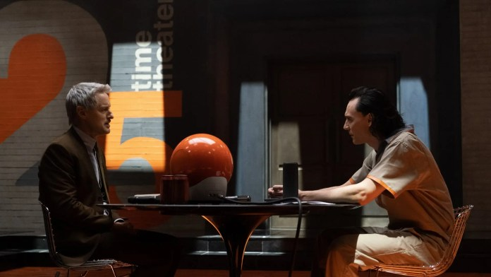 Loki and Agent Mobius in an interrogation room.