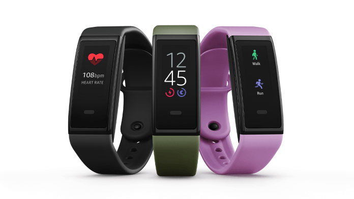 The Amazon Halo View fitness band in black, green, and purple.