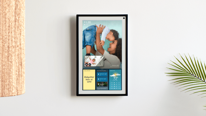 The Echo Show 15 mounted on a wall in portrait mode.