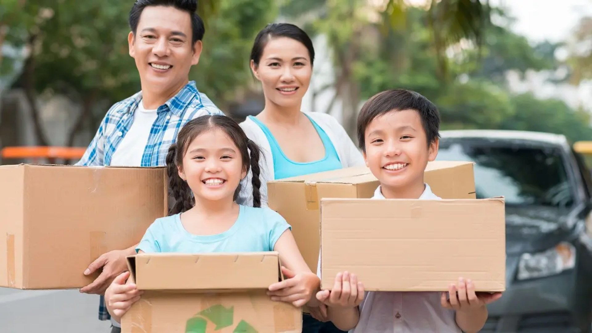 A family holds boxes for charity.