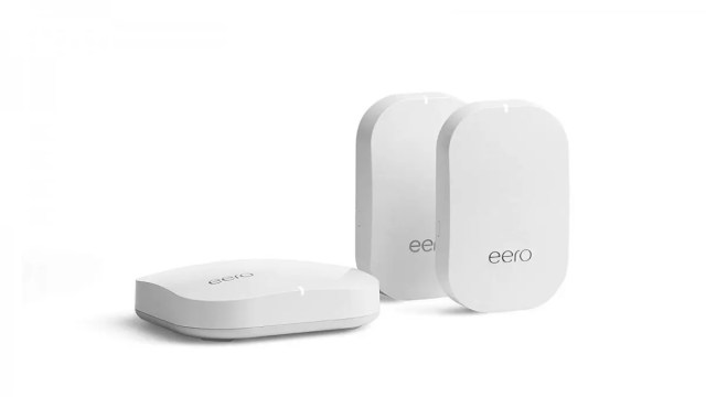 An eero pro router and two eero tags on a white background.