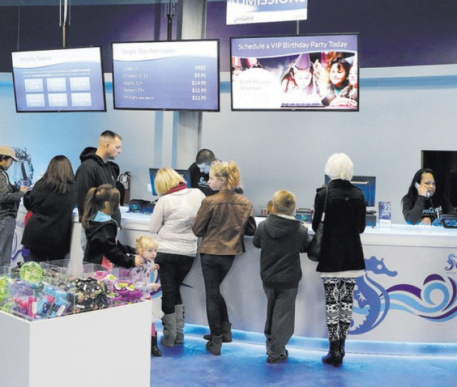 Visitors Arrive At The Boulevard Malls New Seaquest Interactive Aquarium On Its Grand Opening Day