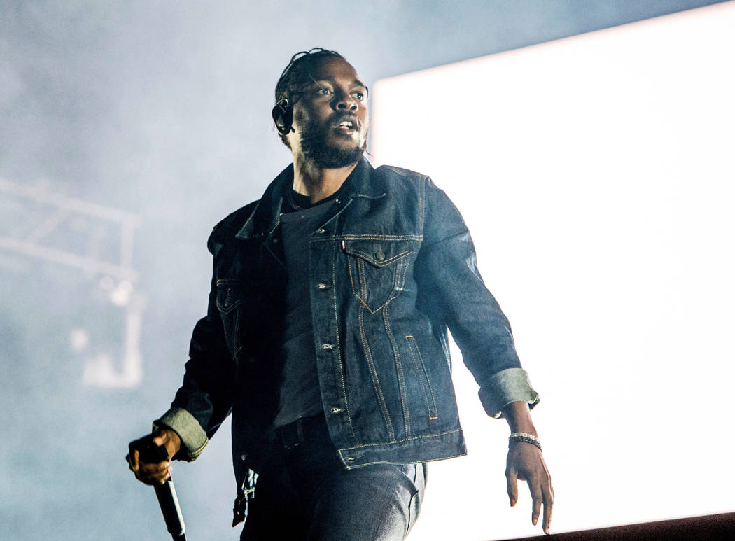 FILE - In this July 7, 2017, file photo, Kendrick Lamar performs during the Festival d'ete de Quebec in Quebec City, Canada. A list of nominees in the top categories at the 2019 Grammys, including ...