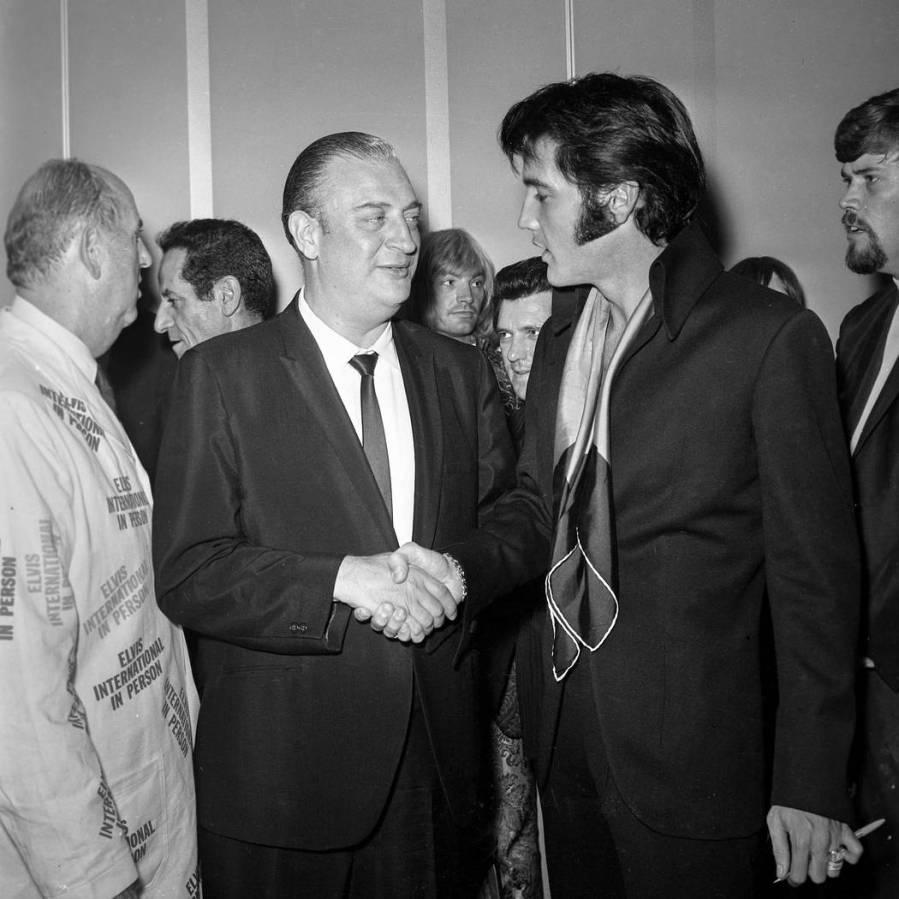 Elvis Presley is greeted by comedian Rodney Dangerfield, left, at the International Hotel in La ...