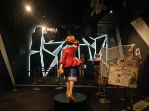 A life sized figurine of luffy's back as he walks forward