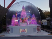 A huge snow globe with Christmas trees lit up and Chopper at the center