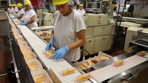 Assembly line production is an example of specialisation. Image credit Youtube.com