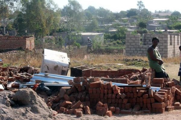 Illegal houses being demolished in Epworth, Harare. Image credit voicesofafrica.co.za
