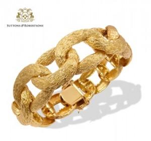 11. Original pulsera formada por eslabones de oro matizado de 18k. Peso.87,10g.Joyas - Suttons & Robertsons
