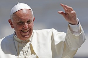 Pope Francis waves after leading his weekly general audience at St. Peter's Square at the Vatican