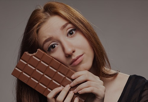 Do not believe that eating chocolate or other sweets will make you feel better