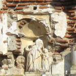 Sculpture of the child Mary in upper niche of Church of Nuestra Señora de los Remedios
